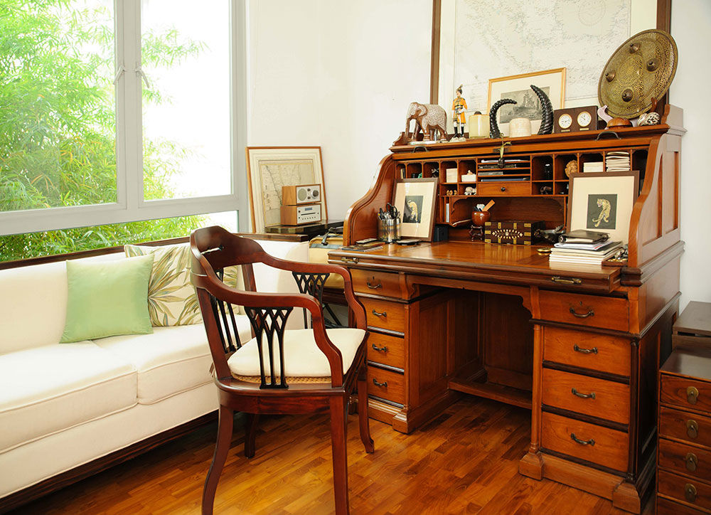 Imagine the quality of the work you'd get done at this stunning 19th century teak and rosewood roll-top desk.